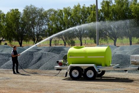 Fire Water Trailer spraying and watering down dust suppression